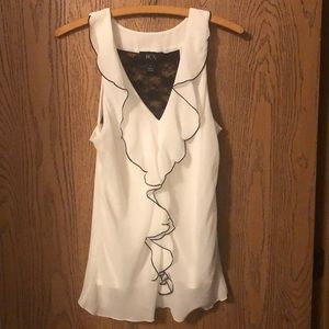 Cute sleeveless black and white blouse